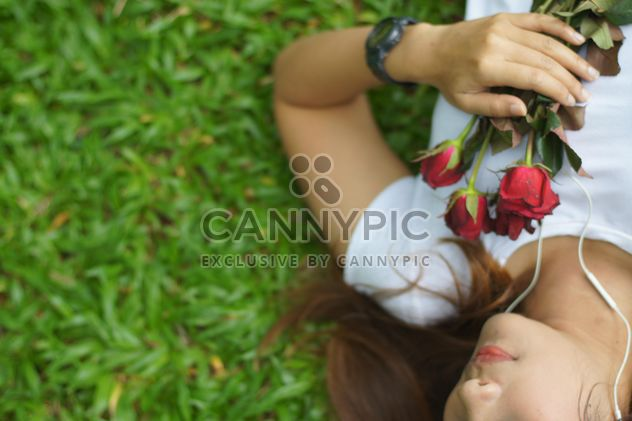 Girl with roses on grass - Free image #339223