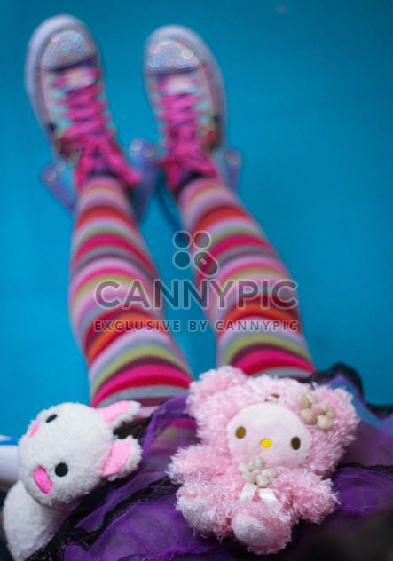 Girl in colorfull tights with soft toys - Free image #342123