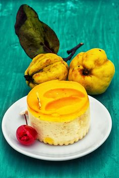 Yellow cake and quinces on green background - бесплатный image #342913