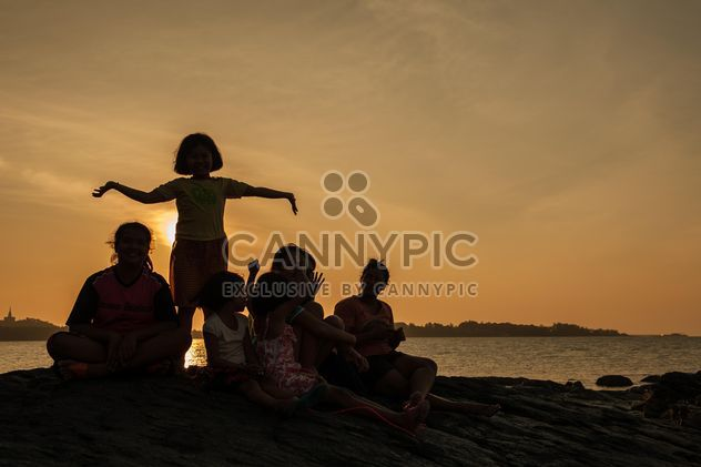 Children on a sea at subset - Free image #344083