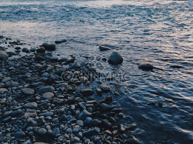 Stones in sea at sunset - Free image #344513