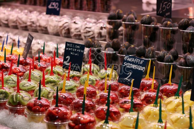 Fresh fruits in plastic cups at market - Free image #344553