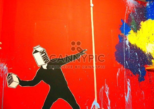 Graffitis lumineux sur le mur rouge - image gratuit #345113
