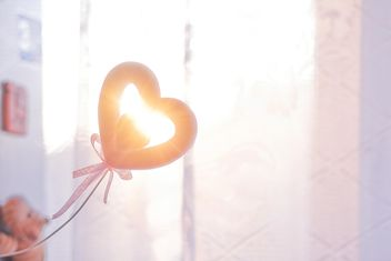 Decoration in shape of heart in sunlight - бесплатный image #345893