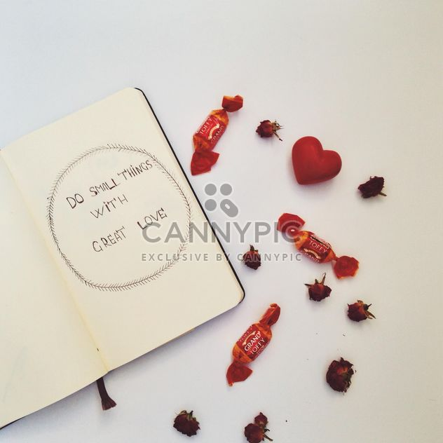 Open notebook, candies and small dry roses - Free image #346583