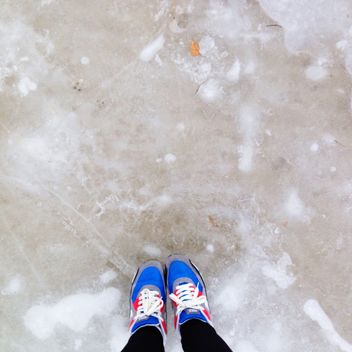 Feet in colorful sneakers on ice - бесплатный image #347173