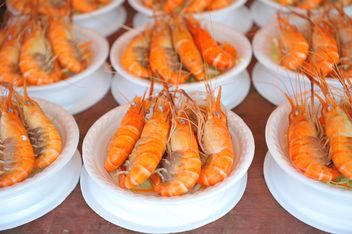 Tasty boiled shrimps in bowls - image #347243 gratis