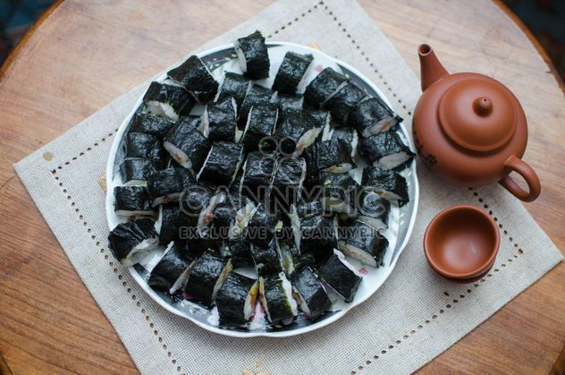 Clay cups, teapot and sushi rolls - Free image #347753