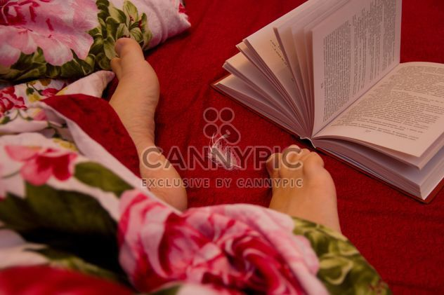 Human feet and open book in bed - Free image #347983