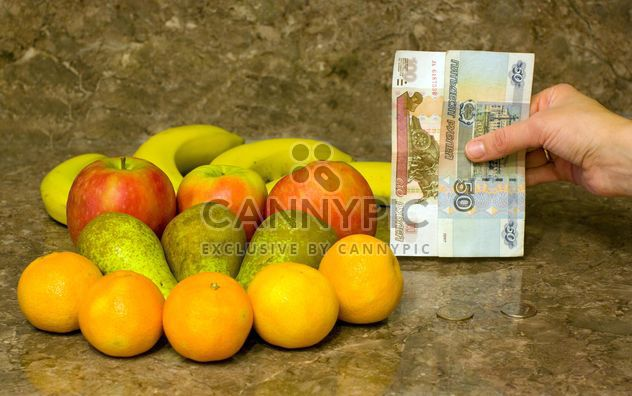 Fresh ripe fruit and money in hand - Free image #348003