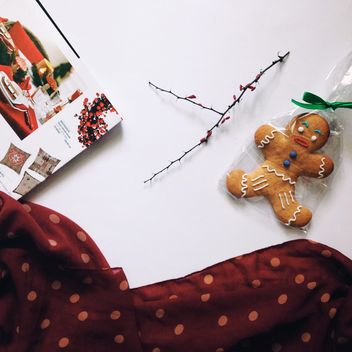 Gingerbread Cookie, twig and open magazine - бесплатный image #348953