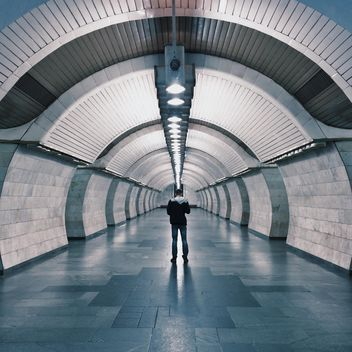 Lonely man in a subway station - image #363723 gratis