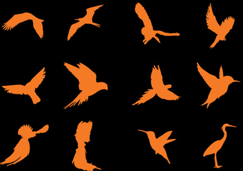 Flying Bird Silhouette Vectors - Free vector #421413