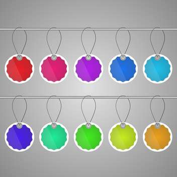 Vector set of colorful tags hanging on ropes on gray background - vector gratuit #129403