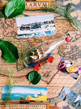 boat in the bottle on the map - бесплатный image #136433
