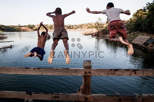 Boys jumping in water - Free image #147913