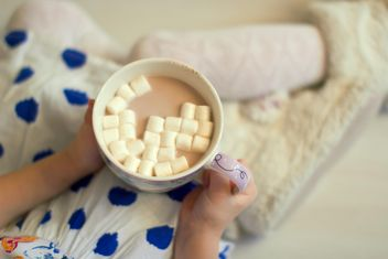 Mug of cocoa in child's hands - Free image #182563