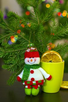 Christmas snowman, cup of tea and fir branch - image #182623 gratis