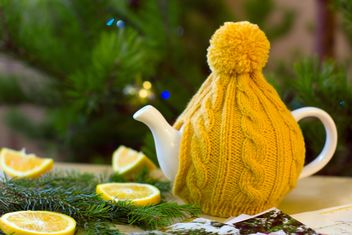 Teapot in knitted hat - image #182633 gratis