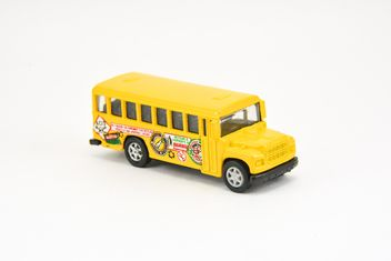 Yellow toy bus isolated on white background - бесплатный image #182813