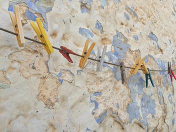 colorful clothespins hanged against wall - image #183143 gratis