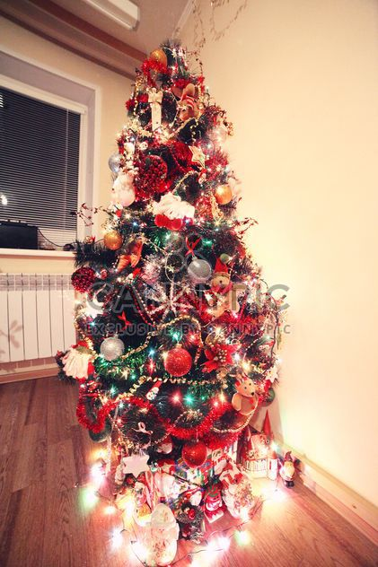 Decorated Christmas tree in room - Free image #183933