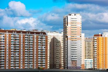 Buildings under cloudy sky - бесплатный image #186063