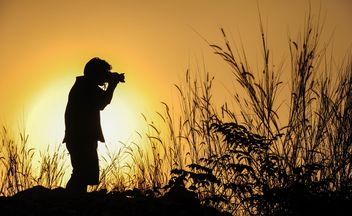 Photographer silhouette at sunset - image #186463 gratis