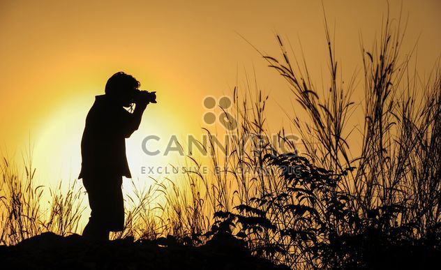 Photographer silhouette at sunset - Free image #186463