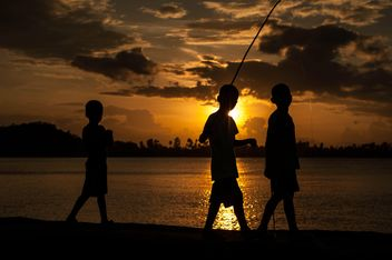 Silhouettes at sunset - Free image #186543