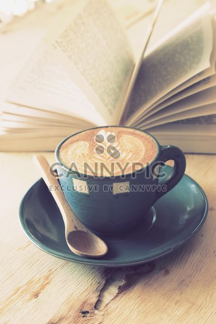 Coffee latte art and open book on wooden table - Free image #187073