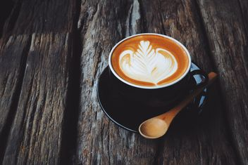 Coffee latte art on wooden background - image #187103 gratis