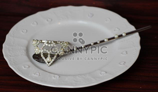 Spoon on a plate decorated with pearls - Free image #187163