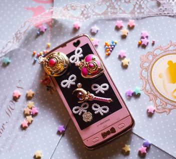 pink smartphone with little white hearts and and bows on white background - бесплатный image #187263