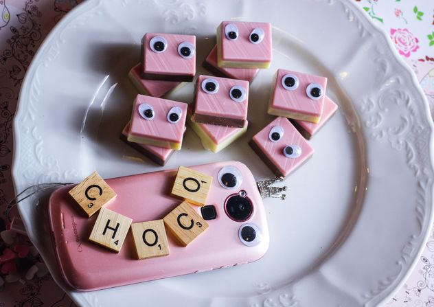 pink sweets with eyes on the plate - image #187313 gratis