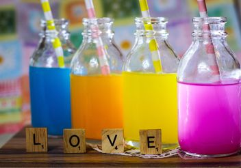 Bottles of colorful drinks - image #187613 gratis