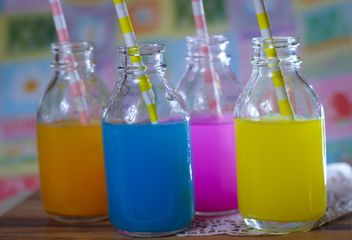 Bottles of colorful drinks - Free image #187623