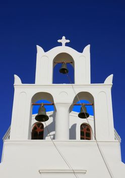 White bell tower in Oia - image #187803 gratis