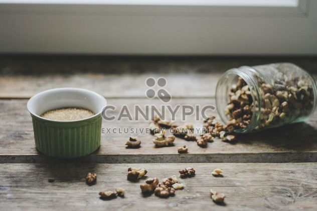 Peeled walnuts on wooden background - Free image #198463