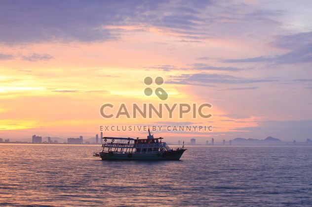 Boat in sea at sunset - Free image #199013