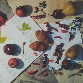 Open book, apples, candies and croissants on the table, #apples - бесплатный image #272163