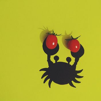 Crab with tomatoes on yellow background - бесплатный image #272203