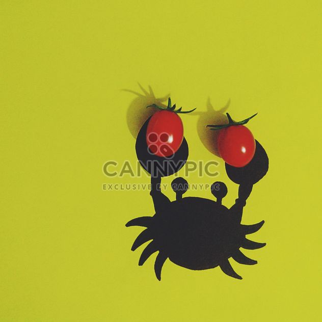 Crab with tomatoes on yellow background - Free image #272203