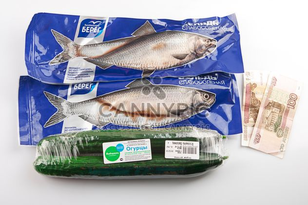 Fish, cucumbers, money on the table - Free image #272563