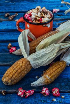 Corn and pop-corn on wooden background - бесплатный image #302053