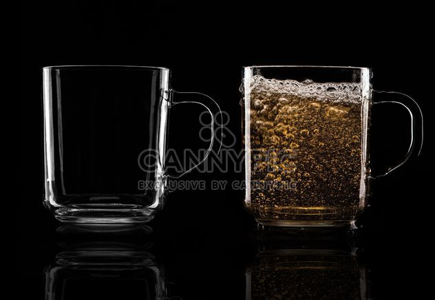 Glass cups on black background - Free image #303223