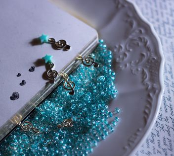 Blue beads on a plate - image #303973 gratis