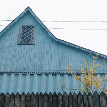 blue wooden house and yellow tree - image #304133 gratis