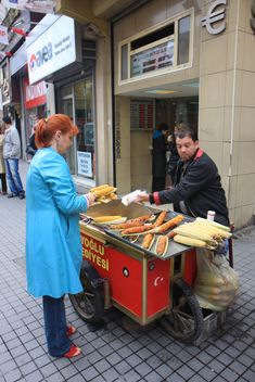 Russian Tourist buying corn - image #305743 gratis