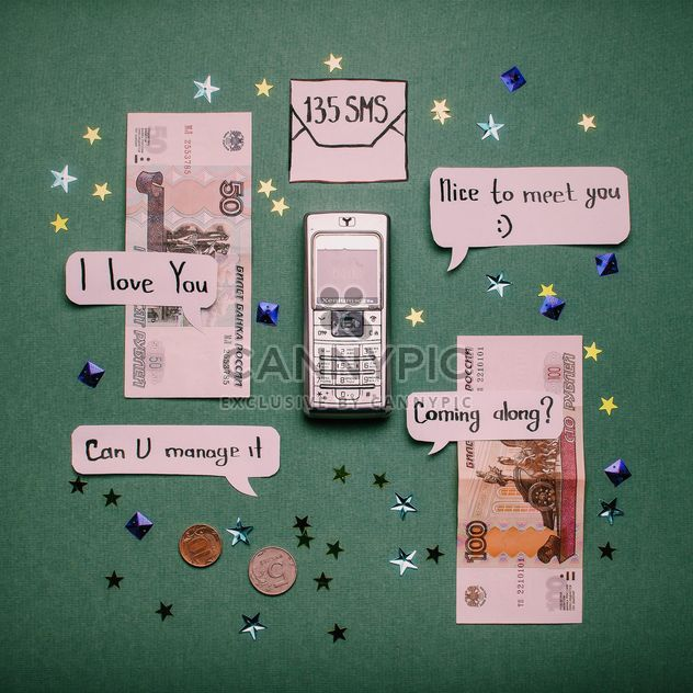 Mobile phone, paper label banners and money - image #305763 gratis